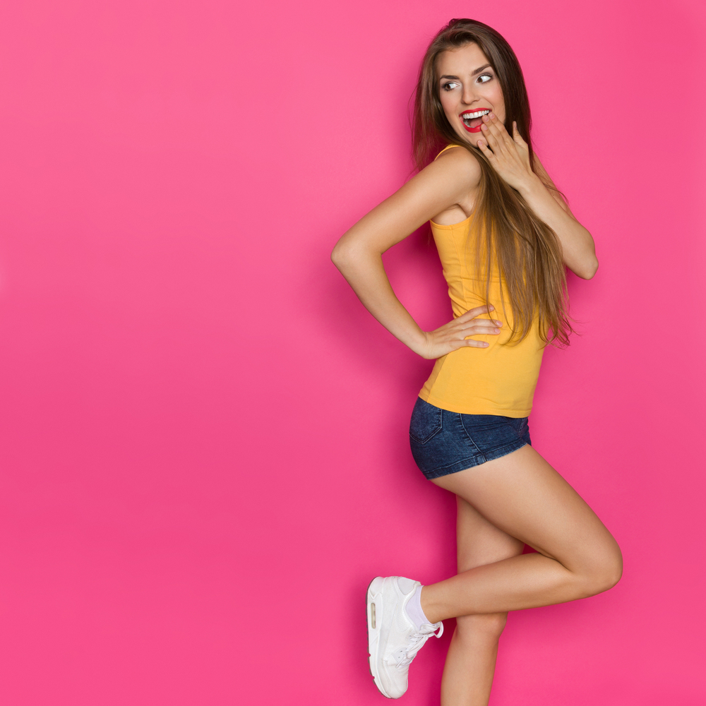 fashionable young woman on pink background