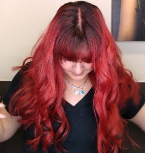 Red curly hair with shadow root